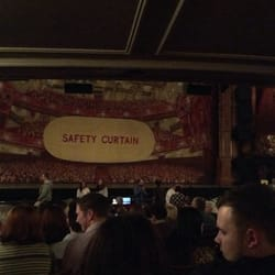 Theater curtain and side of Billy…