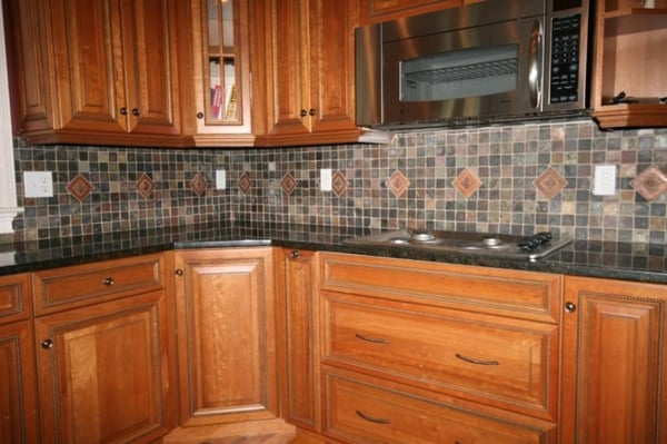 kitchen remodel featuring granite countertops slate tile backsplash