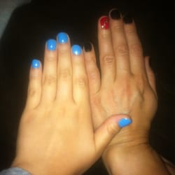 Canty & Marquez Salon & Day Spa - Two manicures: one blue and one black/red - Pacific Grove, CA, Vereinigte Staaten