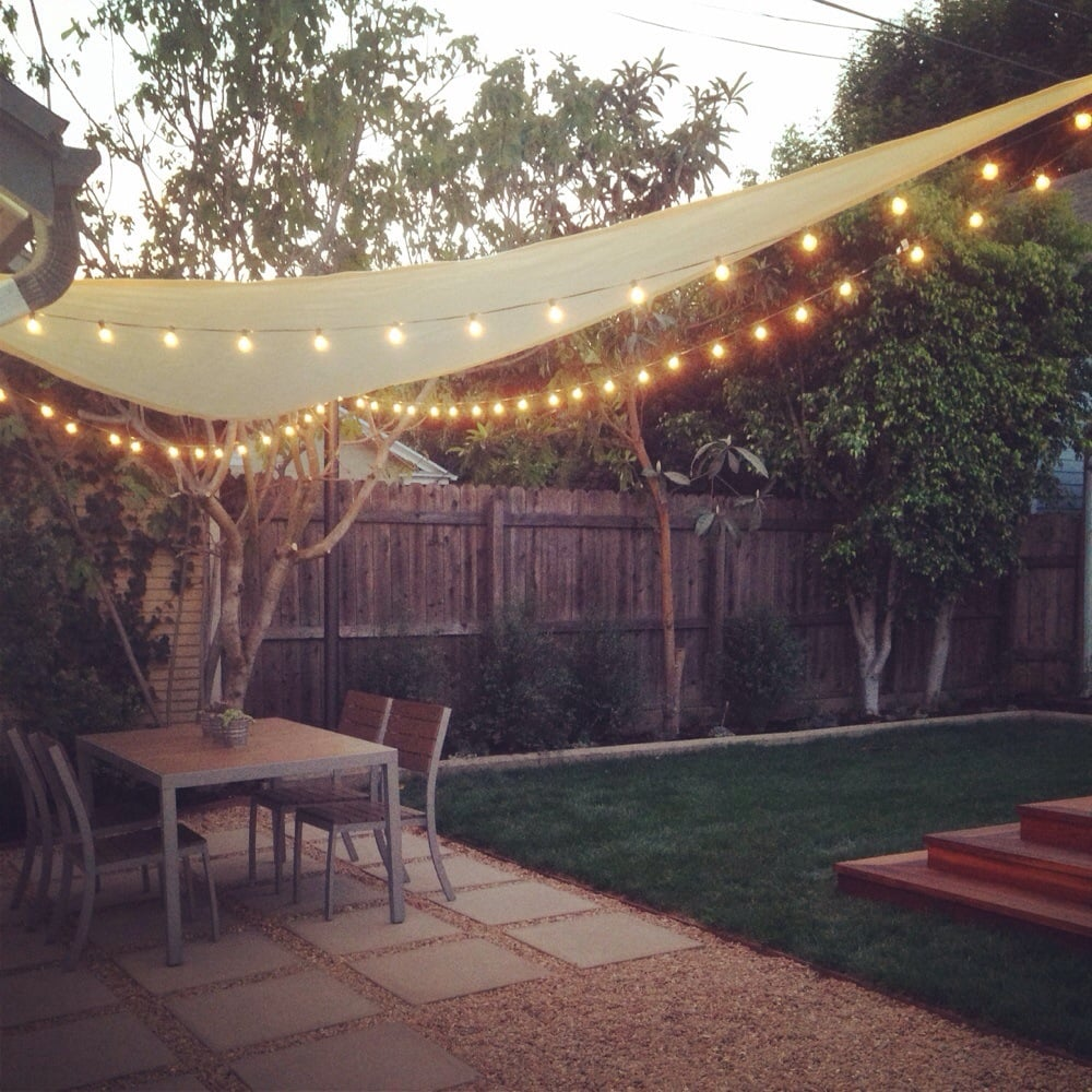Outdoor String Lights On Fence : After- shade sail and string lights under dining area Yelp