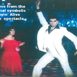 The captioned iconic & symbolic  Saturday Night Fever image is from the choreographically revamped (Stayin`Alive) 1977 film.