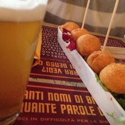 Fried potato balls and blonde beer