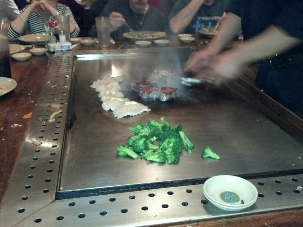 Our dinner being cooked yelp for Steak and fish restaurants near me