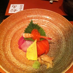 Chirashi don (rice is under the fish,…