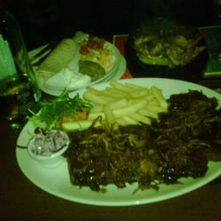 Poor image quality, but there is the combo plate of ribs, porkchops, and wings. On the other side are the fajitas!
