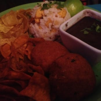 Vegan Cubana Vegetarian Plate. Cuban black beans, Falafel Cubana, plantain/chilli rice and sweet potato and plantain crisps