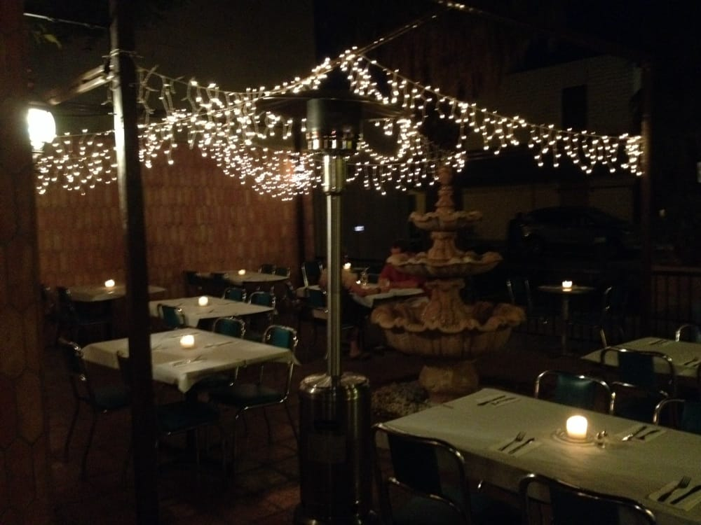 The outdoor patio is beautiful plete with fountain and