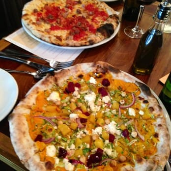 . Happy Hour: Roasted carrot pizza with goat cheese, brussels sprouts ...