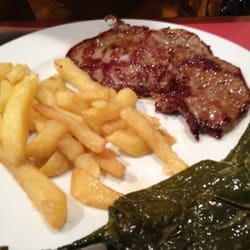 Grilled Veal Steak with fries and…