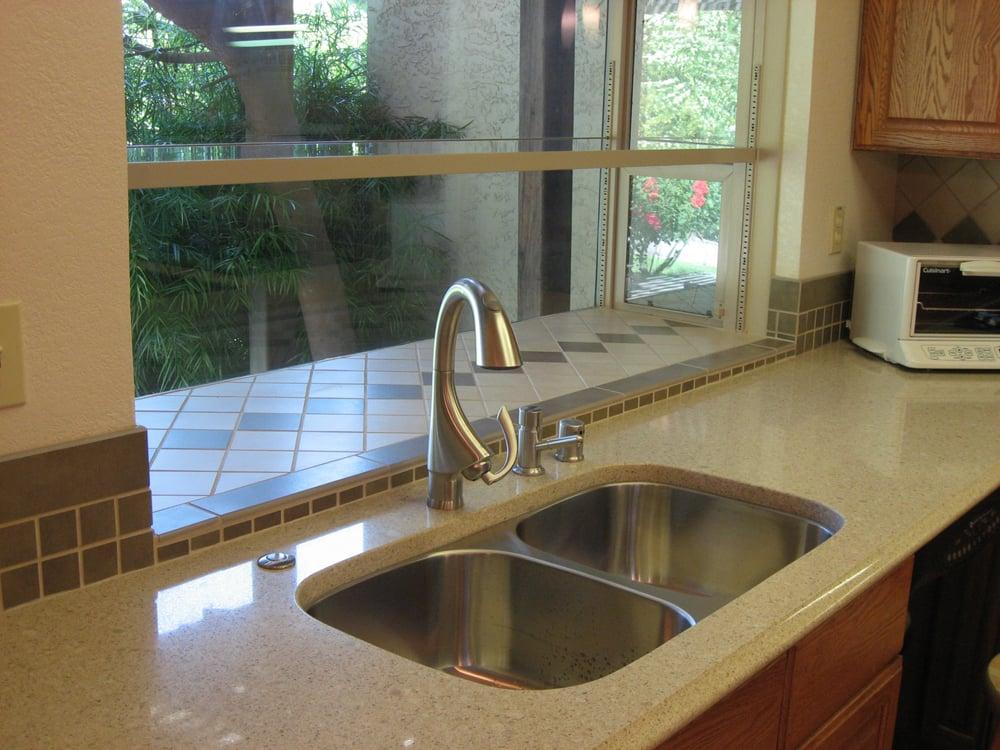 Silestone countertop with dual basin undermount stainless Silestone sink