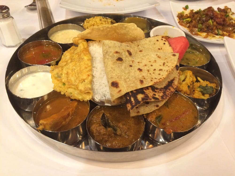 The enormous Non veg thali. Includes Rasam, dal, fish curry ...
