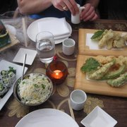 Avocado tempura, egg fried rice, California rolls, sashimi