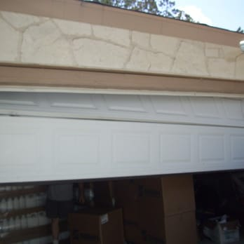 Universal garage door repair 15 photos garage door for Garage door repair los angeles ca