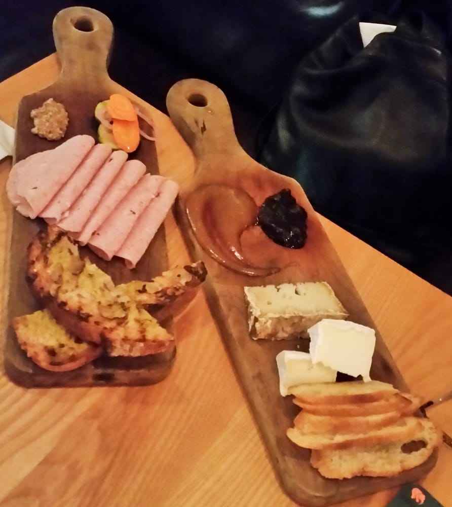 House Charcuterie Mortadella and two Vermont cheeses served with Vermont appl