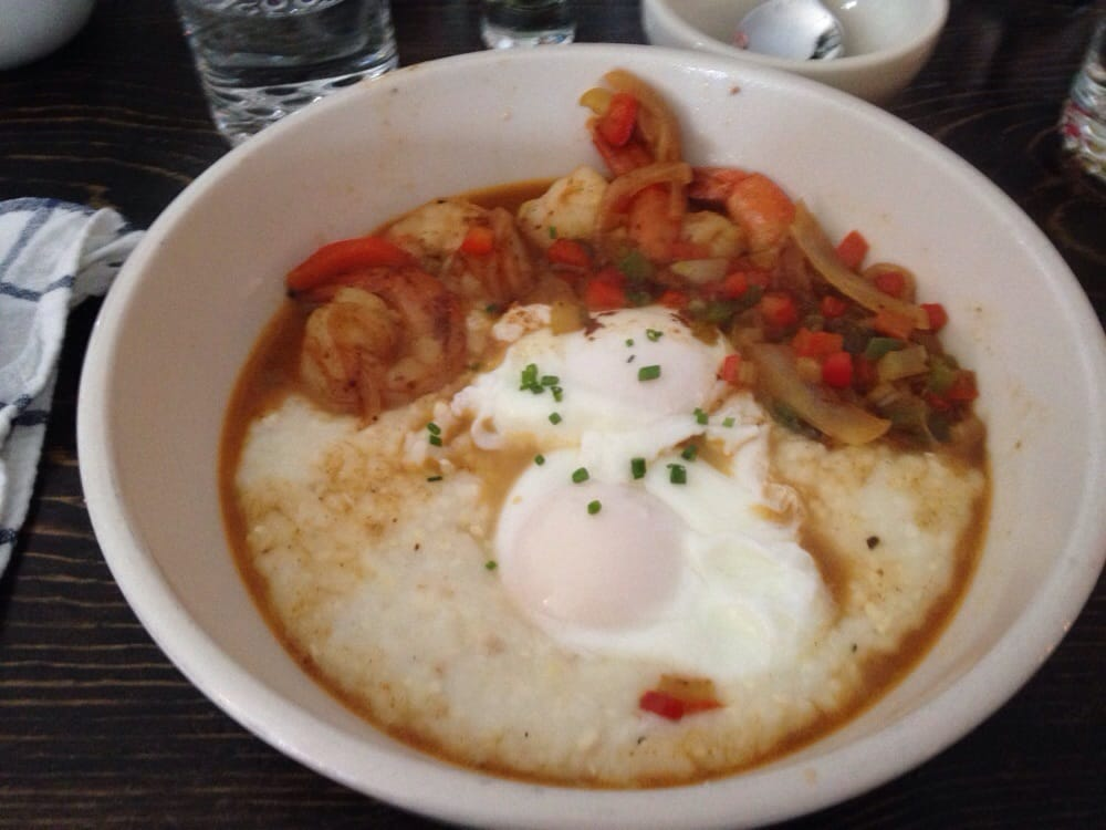 Shrimp and grits with poached eggs. - Yelp