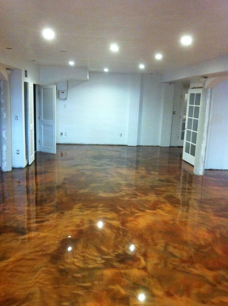 basement floor receives a metallic epoxy coating w two colors coffee