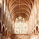 Hereford's fine Norman nave, with the clerestorey rebuilt in the later decorated gothic style, facing the west window.