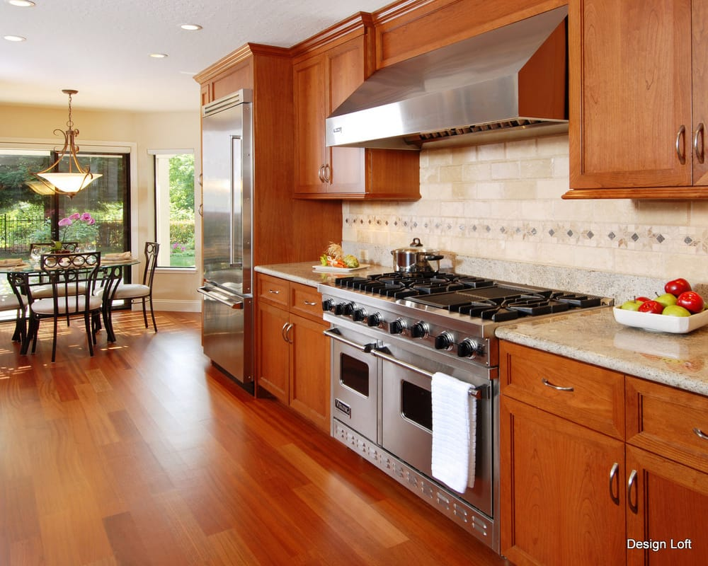 Cherry Cabinets Combined With Granite Countertops And Limestone Tile Backspla
