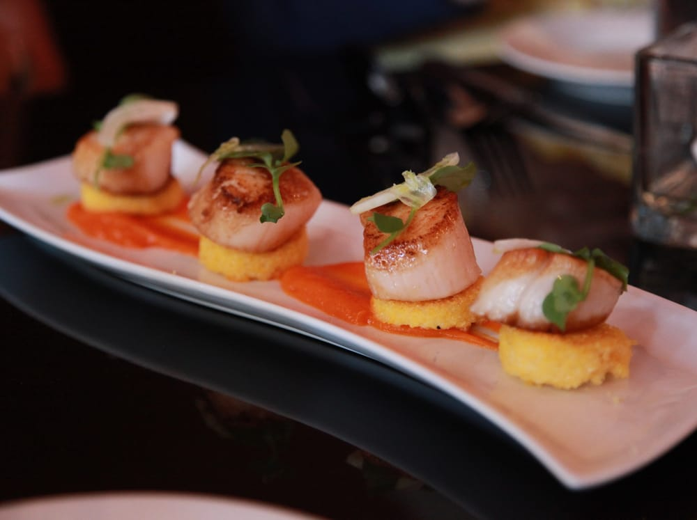 Pan seared scallops served with carrot puree, creamy Polenta cakes and ...