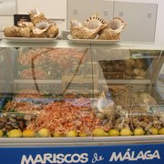 Mariscos (shellfish).  Note the variety of gambas (shrimp), scampi, crabs & clams, and the conchs on top!