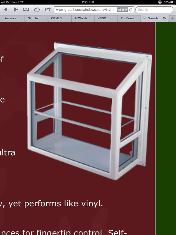 Vinyl garden window with rounded edges and a glass shelf for Vinyl windows company