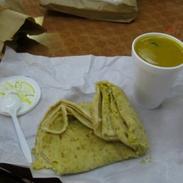 something to nosh on: a cup of delicious daal and daal roti.