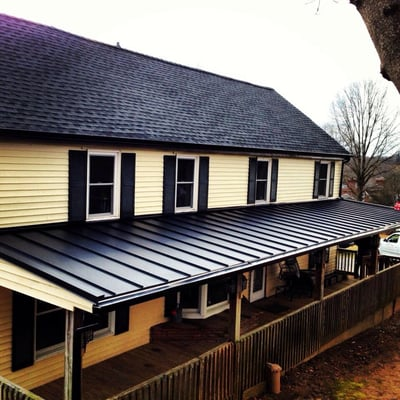 Gaf charcoal shingles with black standing seam metal roof - Black metal roof pictures ...