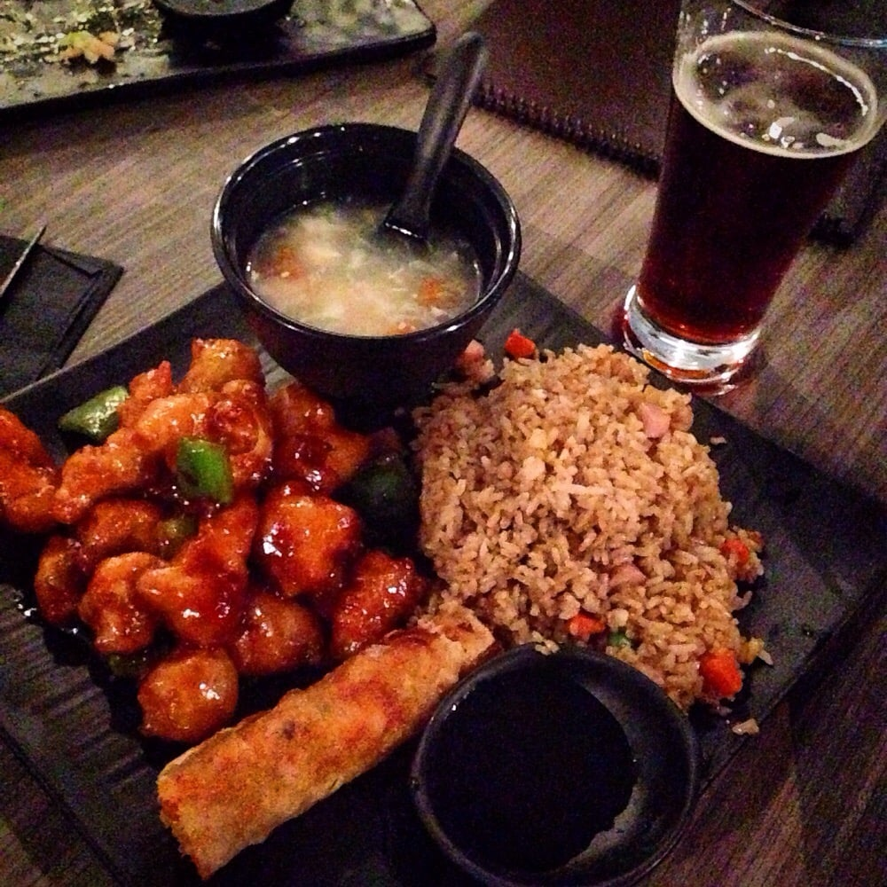 General Tso's chicken with fried rice, egg roll, and tofu soup. - Yelp