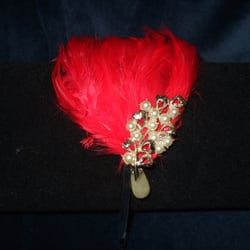Bright red bespoke feather fascinator with vintage pearls