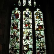 North Aisle, west window: by Kempe.