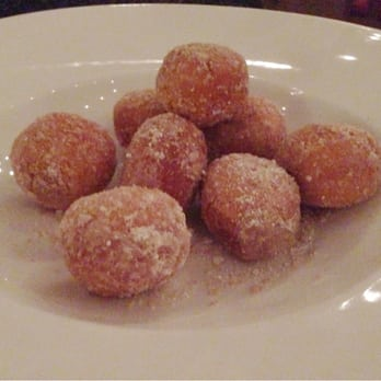 ... deep-fried dough ball dusted in sugar, served with chocolate sauce