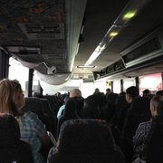 Lucky Star Bus - New York, NY, États-Unis. broken air conditioning system with bags suspended from ceiling...