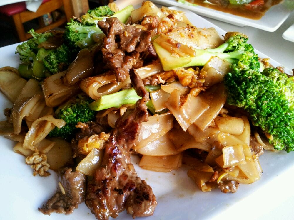 Pad See Ew/Seiew w/Beef ($8.95): Stir-fried flat rice noodles w ...