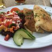 Spargelpfannekuchen (savory pancake filled with white asparagus, cheese, and ham)