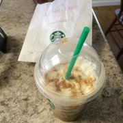 Starbucks - Placerville, CA, États-Unis. My already eaten cake pop bag and my caramel frap!!