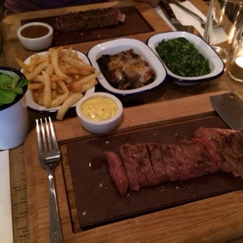 Flat iron steak, sides dripping cooked chips, roast aubergine, creamed spinach