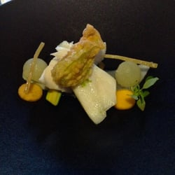 Le Saint James - Bouliac, Gironde, France. John Dory steamed in lobster juice glazed with lime zest, zucchini flower, melon and thorn barberry