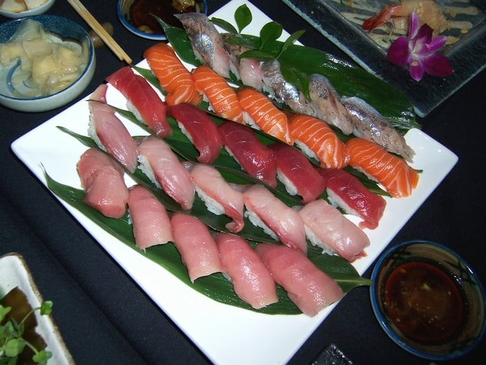 Nigiri sushi assortment toro tuna yellowtail salmon for Yellowtail fish sushi