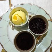 Clotted cream and two types of jam.