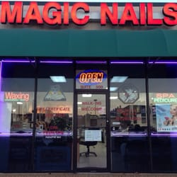 In front of Magic Nails at daytime. We… by Dan L.
