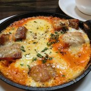 Bastille Cafe & Bar - Pork belly with baked eggs for brunch! - Seattle, WA, Vereinigte Staaten