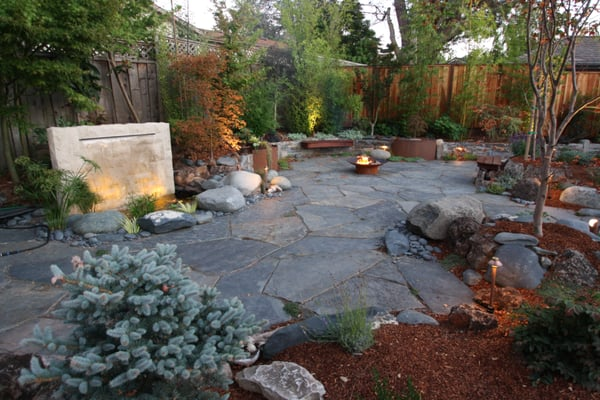 Slate patio with water feature and firepit yelp for Drought resistant grass crossword clue