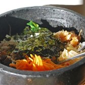 Vegetarian bibimbap (without the egg on top!) in a dolsot - hot sizzling bowl.