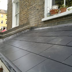 A completed slates roof and lead flashings.