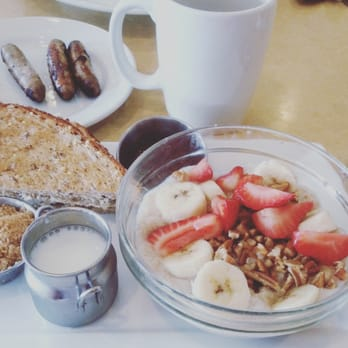 Oatmeal with strawberries, bananas, almonds, brown sugar, and low-fat ...