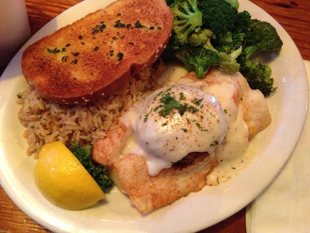 Baked grouper stuffed w a crab cake white sauce w rice for Crab topping for fish