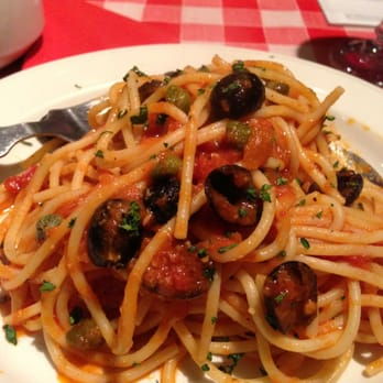 Spaghetti Alla Putanesca , which literally means Whore's Spaghetti is an earthy dish of anchovies, olives, capers and tomatoes