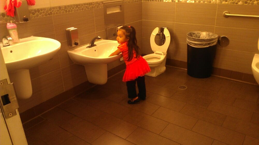 Family restroom with kiddie sinks. Excellent.   Yelp