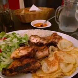 Chez Paulo - Marseille, France. Churrasco de poulet mariné et lamelles de pommes de terre frites