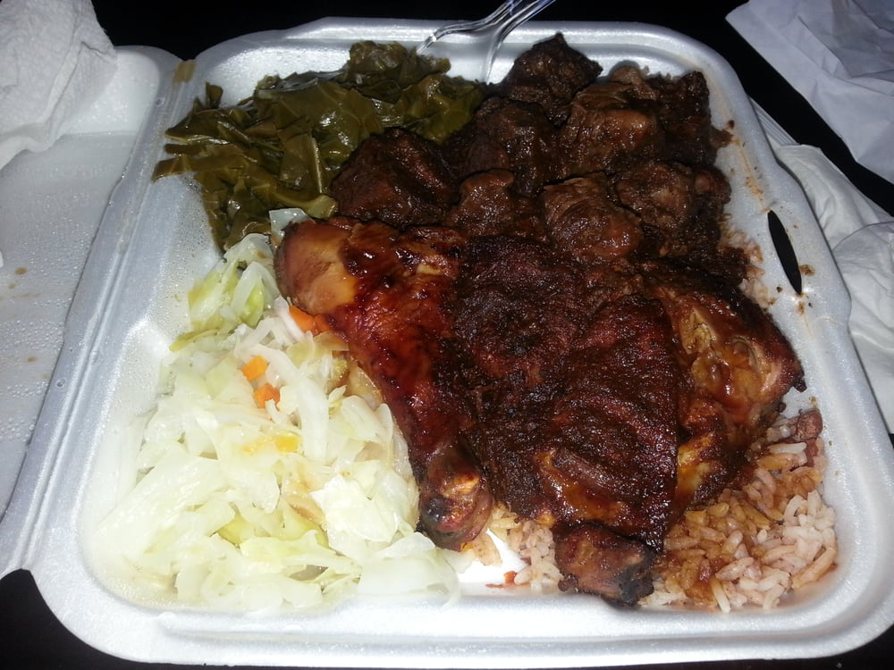jerk chicken ox tails with rice peas cabbage and